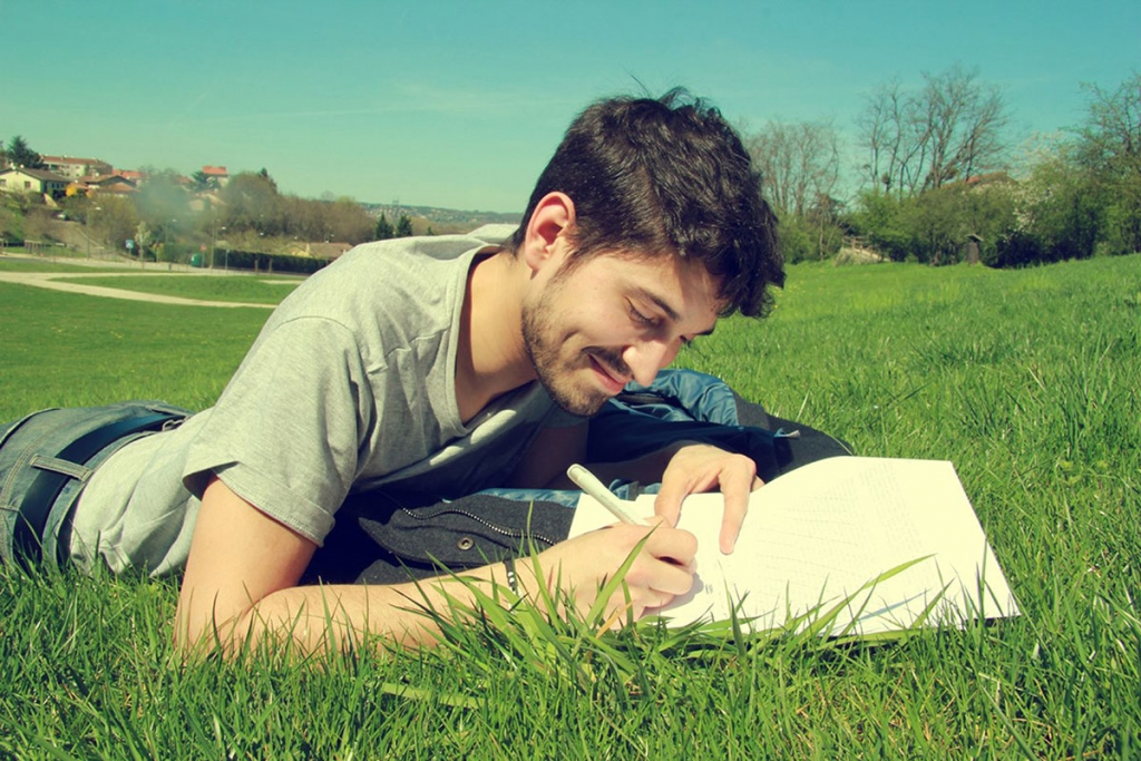 Building-Passion-Man-writing-in-grass